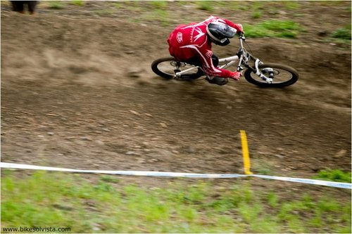 Kain Leonard rails a berm near the finish of the DH track